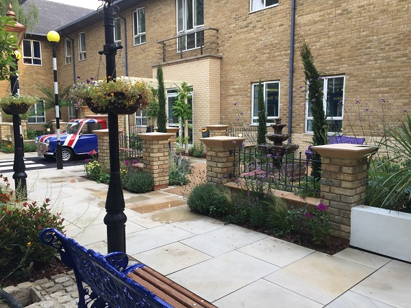 Ball top design wrought iron railings fitted on top of brick wall