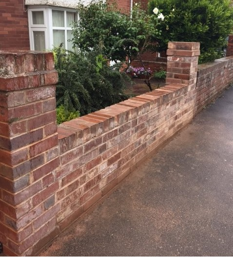 Brick pillars built ready to install wrought iron raiings