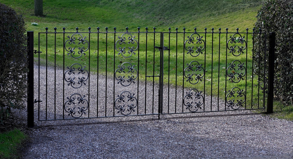 Double metal driveway gates fitted to front entrance of home