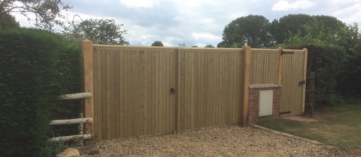 Drayton pressure treated double wooden estate gates fitted to wooden posts