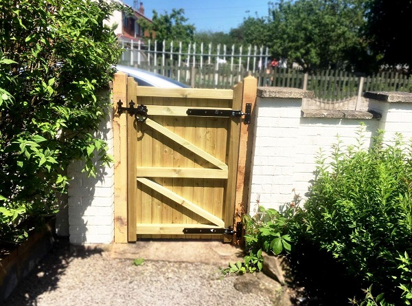 Hook and band hinges fitted to the back face of a wooden garden gate