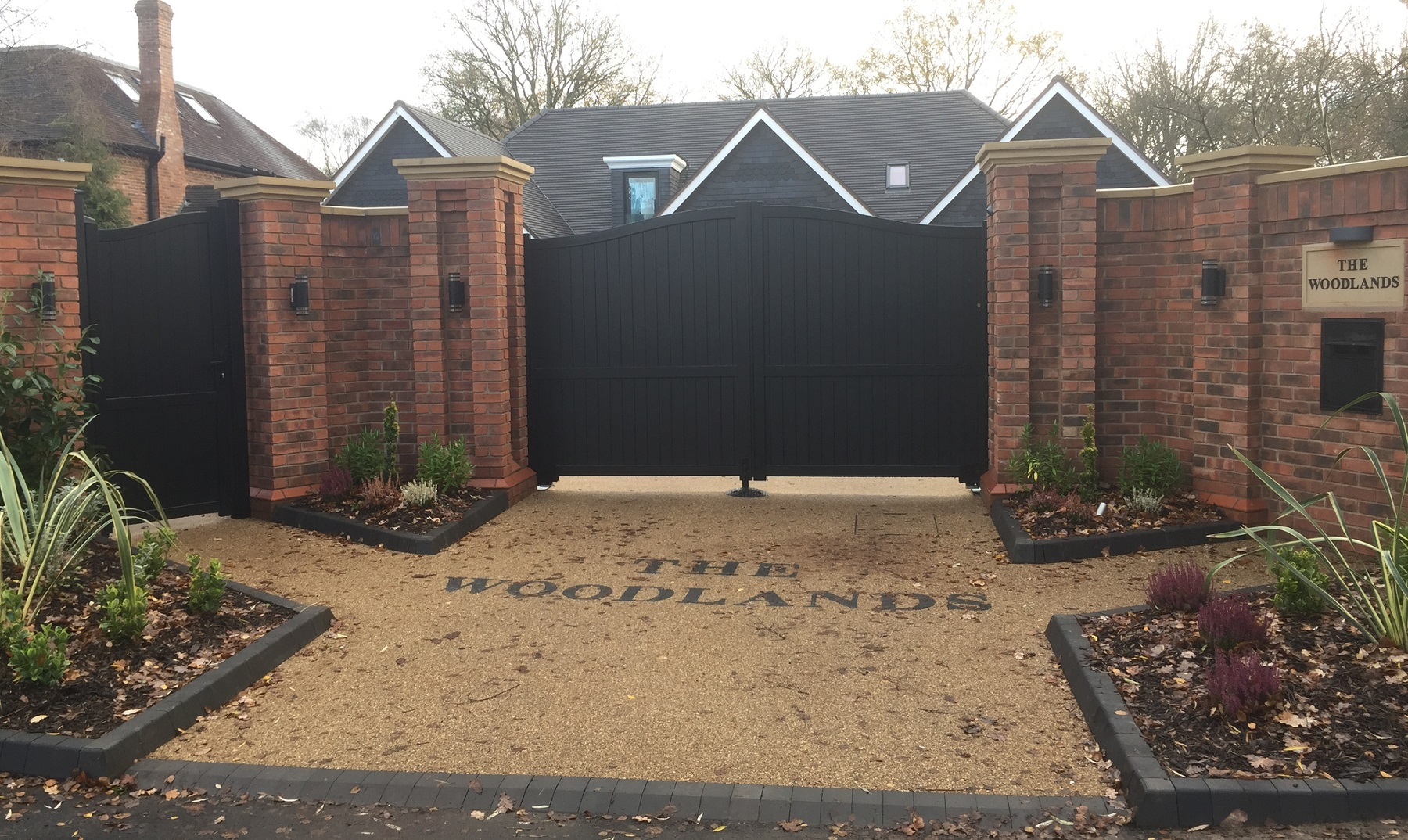 Aluminium gates fitted to large driveway entrance with matching curved pedestrian gate