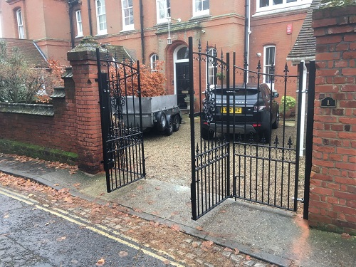 Wall mounted metal posts used to hang heavy duty wrought iron gates