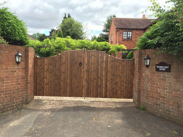 Essex double wooden driveway gates stained dark brown