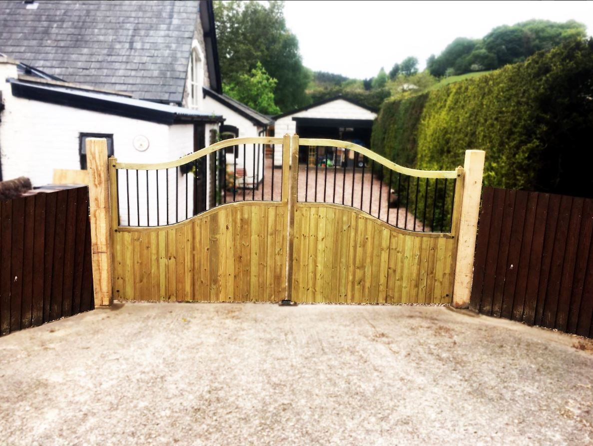 Shrewsbury estate gates with a light oak stain