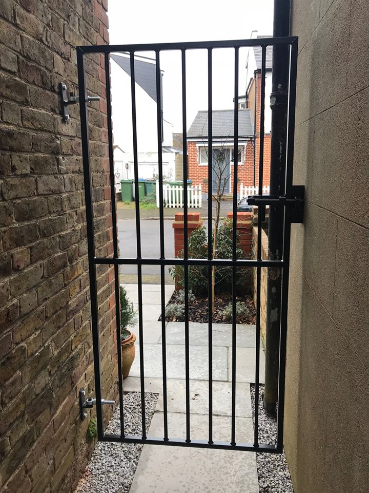 Custom made metal side gate to secure a passageway between houses
