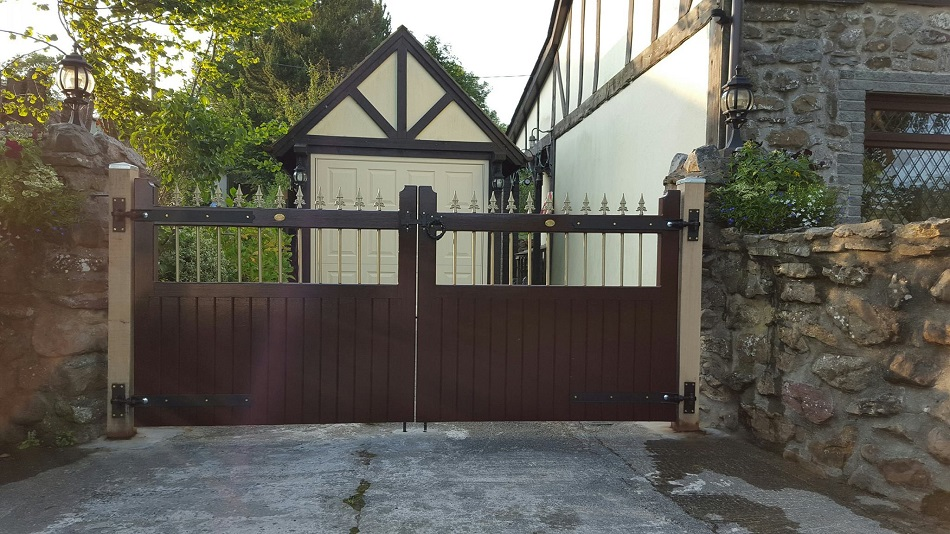 Vertifleur wooden driveway gates with a dark walnut stain