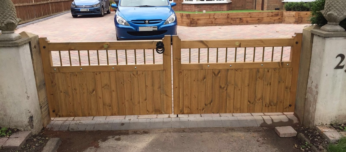 Double wooden driveway gates with metal infill panels fitted to detached Cheshire home