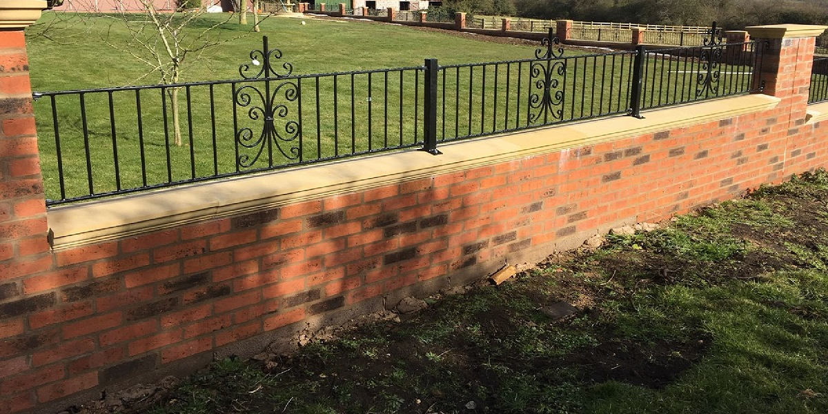 Wrought iron railings installed to a brick boundary wall